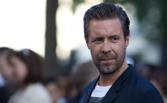 English actor Paddy Considine poses for pictures on the red carpet for the world premier of the film 'The World's End' in London's Leicester Square on July 10, 2013. AFP PHOTO/ANDREW COWIE (Photo credit should read ANDREW COWIE/AFP/Getty Images)